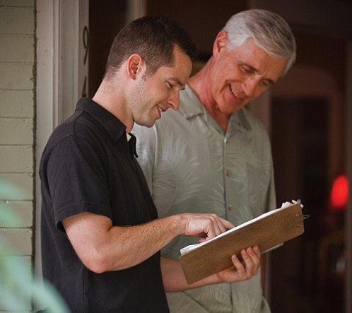 Two Men Discussing Home Automation Installation