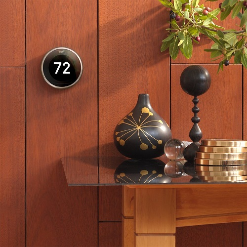 Nest Learning Thermostat on Wall next to a Table