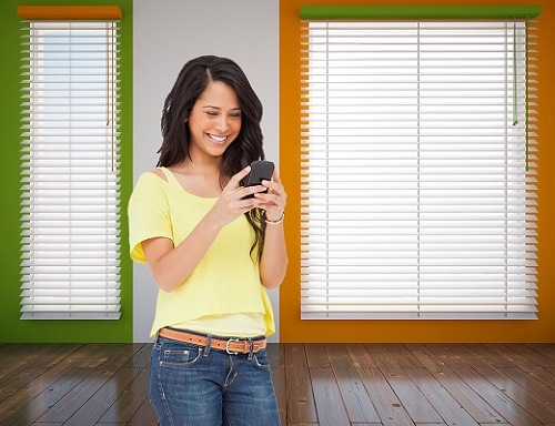 Woman Controling Blinds over Smartphone Using iBlinds
